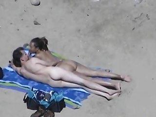 Horny couple at a nudist beach voyeur