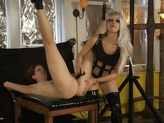 Leathered up blondie uses a dildo and a vibrator in BDSM skit