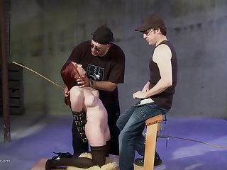 Submissive redhead has her hands tied behind her relating to and deep throats