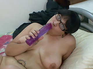 Chunky Asian girl around glasses toys not far from her big shaved pussy