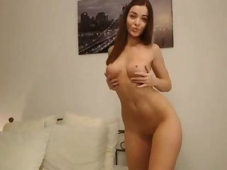 Busty babe loves stripping with the addition of teasing you on webcam