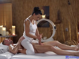 Sexy masseuse Shalina Devine oiled up together with fucked by a horny client