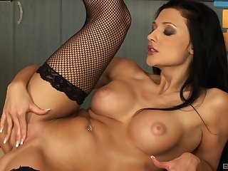 Closeup pic of a naughty pornstar pleasuring her pussy with a dildo